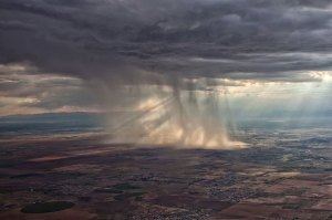 distant-storm-cloud-seen-from-airplane-window